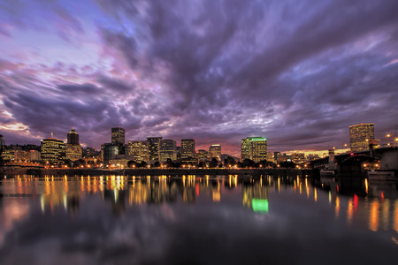 Portland Oregon Downtown Waterfront City Skyline with Reflection on Willamette River After Sunset 스톡 콘텐츠