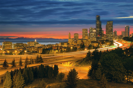 Seattle Washington City Skyline with Freeway Light Trails After Sunset