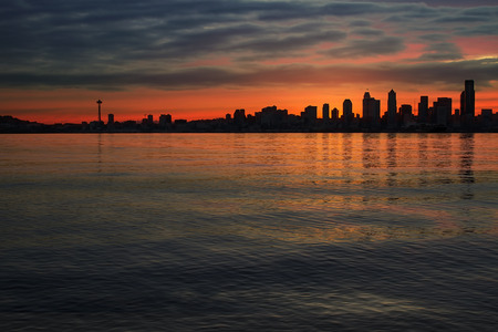 Seattle Washington City Skyline Silhouette at Early Morning Dawn Sunrise Along Puget Sound photo