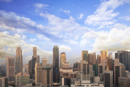 commercial district: Singapore Central Business District City Skyline with Cloudy Blue Sky Stock Photo