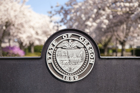 state of oregon: SALEM, OREGON - MARCH 23, 2014: Seal of the State of Oregon Sign at Salem Oregon State Capitol State Park Closeup Editorial