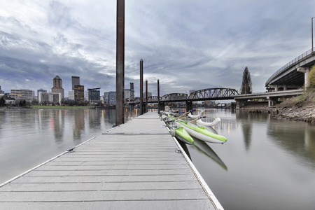 eastbank: Moorage at Portland Downtown Waterfront on the Willamette River with City Skyline at Dusk Stock Photo
