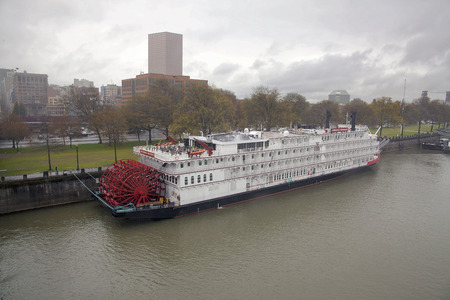mississippi river: PORTLAND, OREGON - APRIL 5, 2014: Day of the dedication ceremony for the American Empress along the seawall of Portland Oregon downtown waterfront city skyline. American Empress is the largest riverboat west of the Mississippi. Editorial