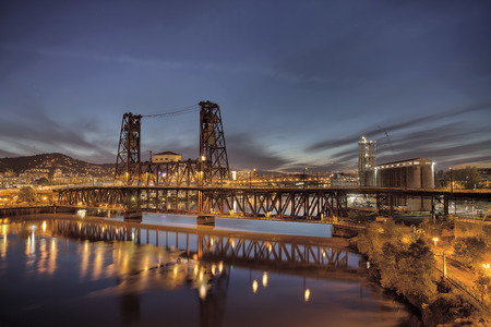 Steel Bridge with Broadway and Fremont Bridges Over Willamette River at Evening Blue Hour in Portland Oregon photo