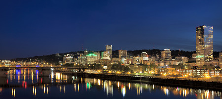 portland oregon: Portland Oregon Downtown City Skyline Along Willamette River Waterfront at Evening Blue Hour Panorama Stock Photo