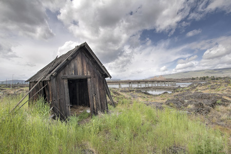 gorge: Old Abandoned Native American Fishing Shacks Along Columbia River by the Dalles Bridge in Oregon