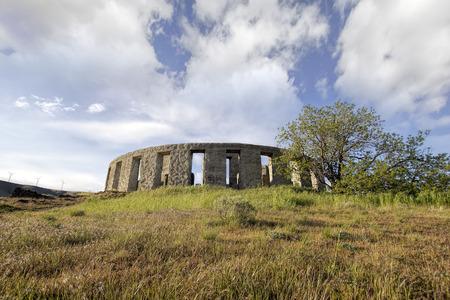 stonehenge: Stonehenge Replica Memorial at Maryhill Washington with White Clouds Blue Sky Scenic Landscape