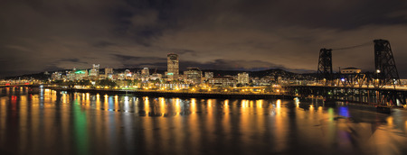portland oregon: Portland Oregon Downtown City Skyline and Bridges Along Willamette River Waterfront at Night with Storm Clouds Panorama