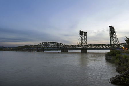 Interstate Bridge I-5 Over Columbia River Waterfront After Sunset at Dusk Between Oregon and Washington States photo