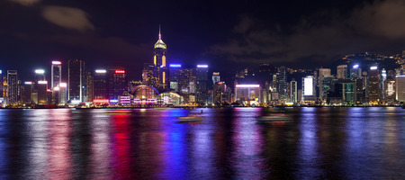 Hong Kong Island Central City Skyline Along Victoria Harbor at Night with Colorful Reflection Panorama photo