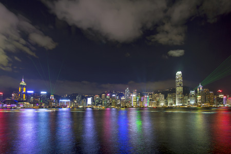 Symphony of Lights Show and Hong Kong Island City Skyline Along Victoria Harbour at Night viewed from Tsim Sha Tsui in Kowloon  This is a nightly show and is a major tourist attraction