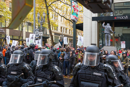 financial stability: PORTLAND, OREGON - NOVEMBER 17, 2011: Portland Police in the streets of Downtown Portland, Oregon during a Occupy Portland Protest Against Banks on the first anniversary of Occupy Wall Street
