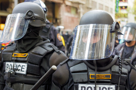 occupy wall street: PORTLAND, OREGON - NOVEMBER 17, 2011: Police in Riot Gears Closeup in Downtown Portland, Oregon during a Occupy Portland Protest Against Banks on the first anniversary of Occupy Wall Street