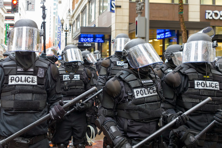 occupy wall street: PORTLAND, OREGON - NOVEMBER 17, 2011: Portland Police in Riot Gear in Downtown Portland, Oregon Street during a Occupy Portland Protest Against Banks on the first anniversary of Occupy Wall Street