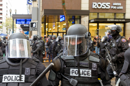 occupy wall street: PORTLAND, OREGON - NOVEMBER 17, 2011: Portland Police in Riot Gear Closeup in Downtown Portland, Oregon during a Occupy Portland Protest Against Banks on the first anniversary of Occupy Wall Street