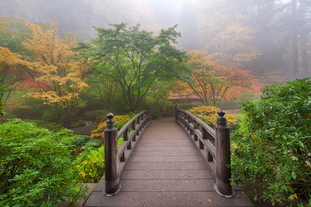 Moon Bridge One Foggy Morning in Autumn at Portland Japanese Garden Stock Photo - 33395550
