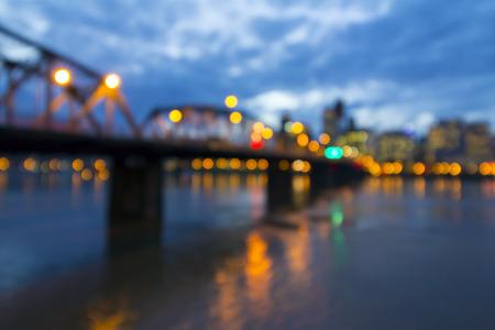 eastbank: Hawthorne Bridge Over Willamette River to Portland Oregon Downtown During Evening Blue Hour Blurred Background