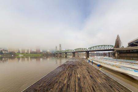 eastbank: Floating Boat Dock on Willamette River with Portland Oregon Skyline and Hawthorne Bridge on Foggy Morning