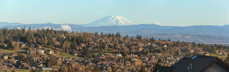 northwest: City of Happy Valley Oregon Homes with Mount St Helens and Mount Rainier Panorama Stock Photo