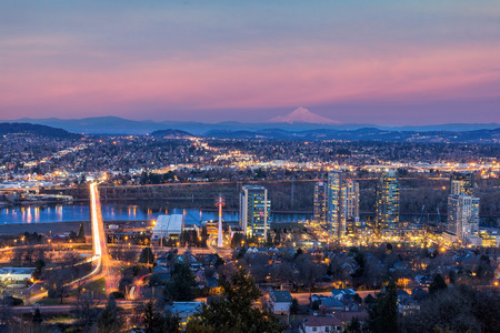 Portland Oregon South Waterfront with Ross Island Bridge Mount Hood Along Willamette River during Alpenglow Sunset Фото со стока