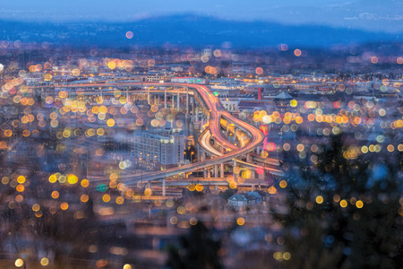 evening out: Portland Oregon Marquam Freeway Light Trails with Blurred Out of Focus Bokeh City Lights during Evening Blue Hour Stock Photo