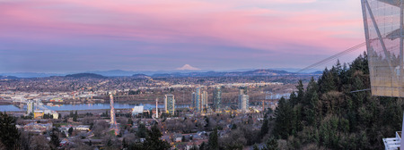 portland oregon: Portland Oregon South Waterfront with Ross Island Bridge Tilikum Crossing and Mount Hood during Alpenglow Sunset Panorama Stock Photo