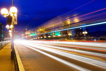light trails: Rush Hour Traffic Light Trails on Cambie Bridge in Vancouver British Columbia Canada during Evening Blue Hour