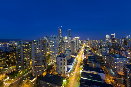 blue hour: Vancouver British Columbia Canada Cityscape along Robson Street During Evening Blue Hour Stock Photo