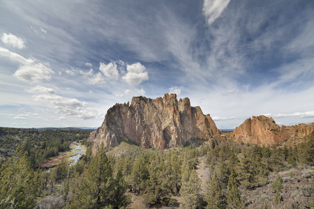 smith rock: Smith Rock State Park in Terrebonne Oregon with White Clouds and Blue Sky Stock Photo