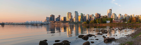 city park skyline: Vancouver British Columbia Canada City Skyline and Deadmans Island from Stanley Park at Sunrise Panorama Stock Photo