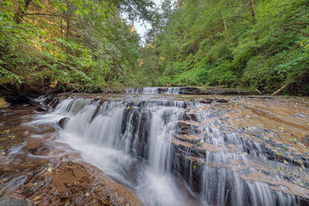 ledge: Tiered Cascading Waterfall Over Wide Ledge at Sweet Creek Falls Trail Complex in Mapleton Oregon