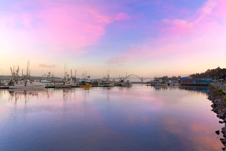 alpenglow: Newport Oregon with Yaquina Bay Bridge by the Marina during Sunset Stock Photo