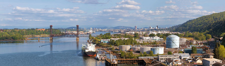 shipbuilding: Portland Oregon Shipbuilding and Repair Shipyard Along Willamette River by St Johns Area with City and Swan Island View Panorama Stock Photo