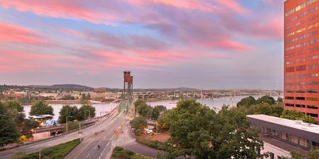 eastbank: Portland Oregon downtown city waterfront and Hawthorne Bridge Tilikum Crossing Marquam Bridge over Willamette River during alpenglow sunset