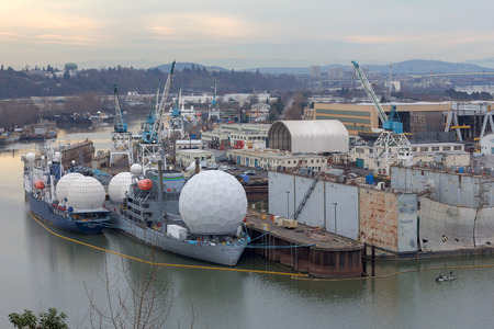 retrofit: Portland, Oregon - February 24, 2015: SS Pacific Collector and Tracker Radar ships docked at Swan Island in Portland Oregon. These ships are maintained by US Maritime Administration to track missiles for Missile Defense Agency, a research arm of the US De