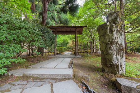 trellis: Stone Path with Wood Entry Structure and Landcaping Rocks at Japanese Garden