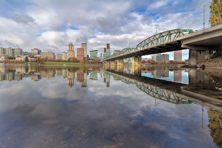 eastbank: Reflection of Portland Oregon downtown city skyline by Hawthorne Bridge on Willamette River daytime Stock Photo