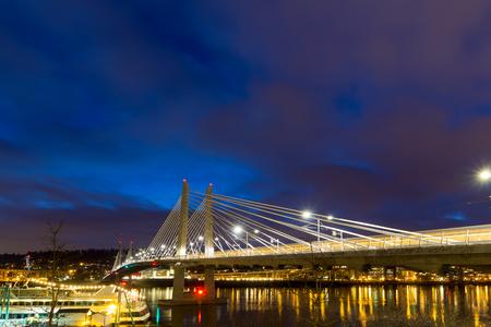 willamette: Train Light Trails on Tilikum Crossing Bridge over Willamette River in Portland Oregon during Evening Blue Hour