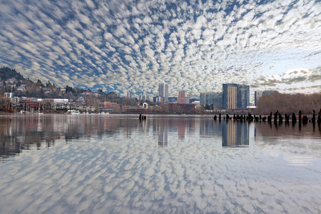 sky reflection: Portland Oregon and South Waterfront Skyline Reflection on Willamette River with Blue Sky and White Clouds