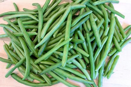 snap bean: Green String Beans on Chopping Board in Kitchen Closeup Macro