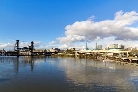 eastbank: Northeast Portland City Skyline and Steel Bridge over Willamette River daytime