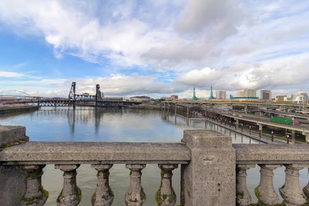 willamette: Northeast Portland City Skyline and Steel Bridge over Willamette River daytime view from Burnside Bridge
