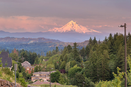 residential neighborhood: Mount Hood evening alpenglow during sunset from Happy Valley Oregon residential neighborhood in Clackamas County Stock Photo