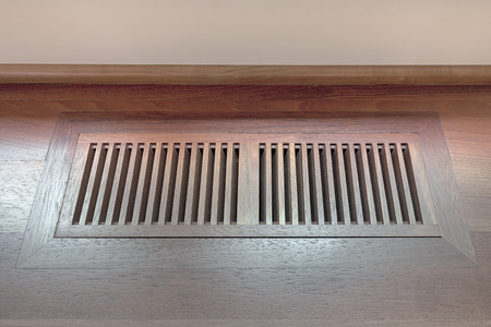 airflow: Wood Floor Vent Cover for home heating and cooling system Stock Photo
