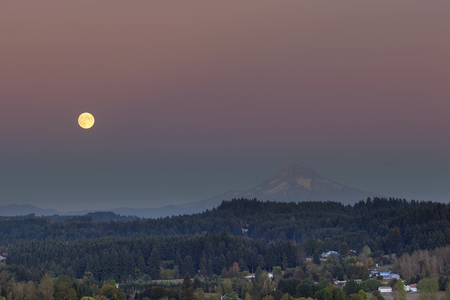 mt  hood: Full moon rising over Mt Hood after sunset in Happy Valley Oregon