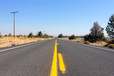low perspective: Middle of the Highway in rural farmland Central Oregon low perspective Stock Photo