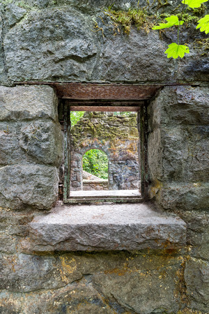 wildwood: Looking through the window of abandoned stone castle house at Wildwood Trail in Forest Park Portland Oregon