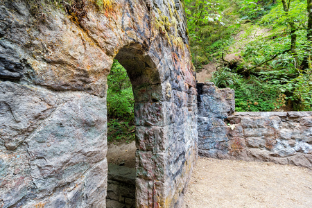 wildwood: Abandoned stone castle house archway at Wildwood Trail in Forest Park Portland Oregon