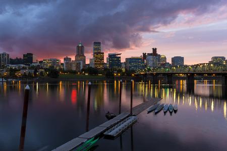 willamette: Portland Oregon city downtown waterfront skyline along Willamette River after sunset at dusk