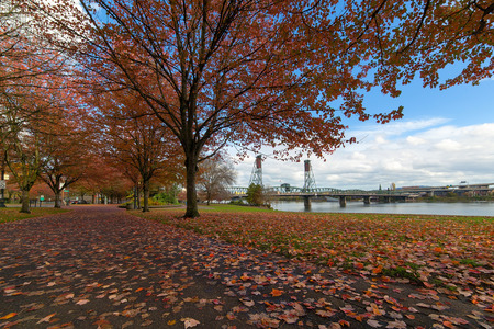 Portland Oregon city downtown waterfront park by Hawthorne Bridge in fall season